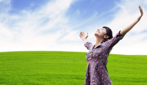 Chiropractic and Acupuncture, image of woman with arms wide and happy about her health