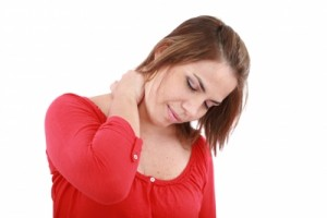 Whiplash, woman holding neck
