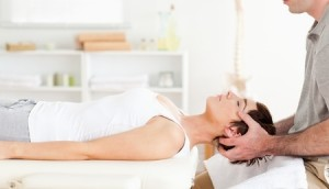 Chiropractor Adjustment of Woman in White Shirt, Image